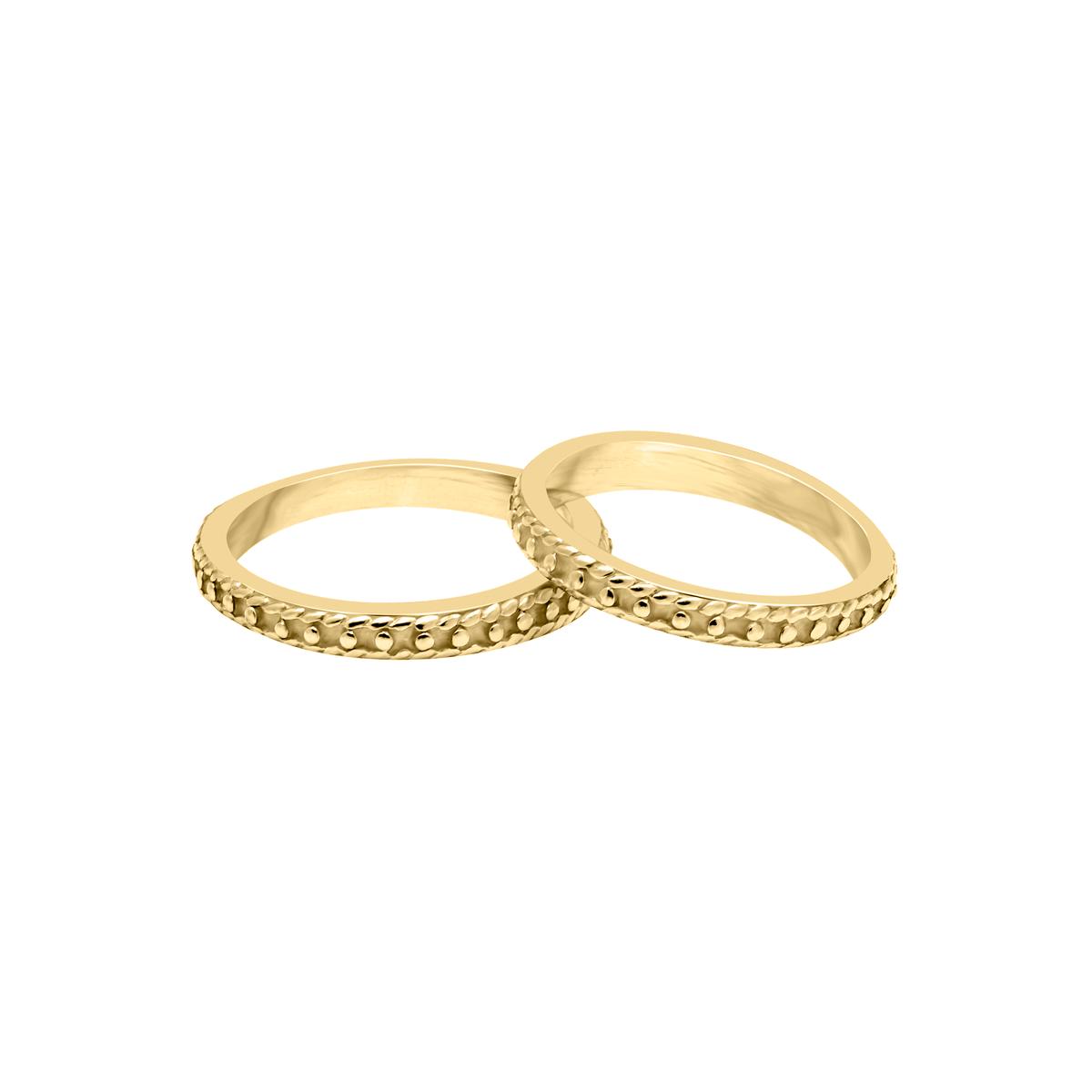 120affaba556 Alianzas en oro amarillo 18 kt con textura de perlitas - Sarah Kosta